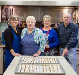 Making divinity candy are, from left, Kim Clay, Susan Harrison, Susan Pacey and Paul Pacey. (Mark Sandlin / Alabama NewsCenter)