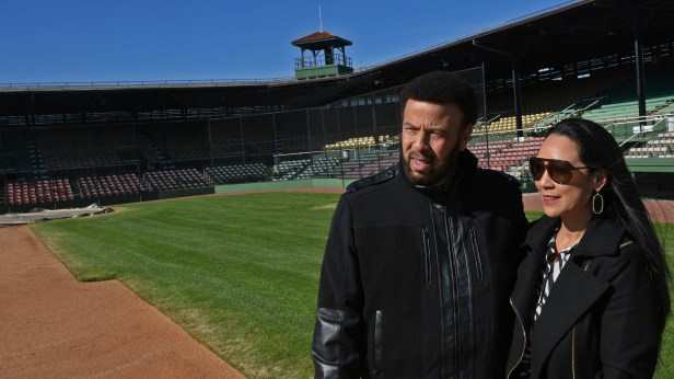 Artie Wilson Jr. and his wife Marie stand on the infield of Rickwood Field. He is the son of Artie Wilson Sr., a member of the Negro League Birmingham Black Barons baseball team. (Solomon Crenshaw Jr. / Alabama NewsCenter)