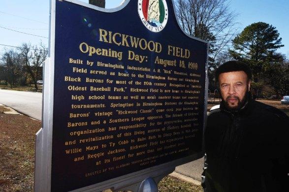 Artie Wilson Jr. poses next to the Rickwood Field historical marker. (Solomon Crenshaw Jr. / Alabama NewsCenter)