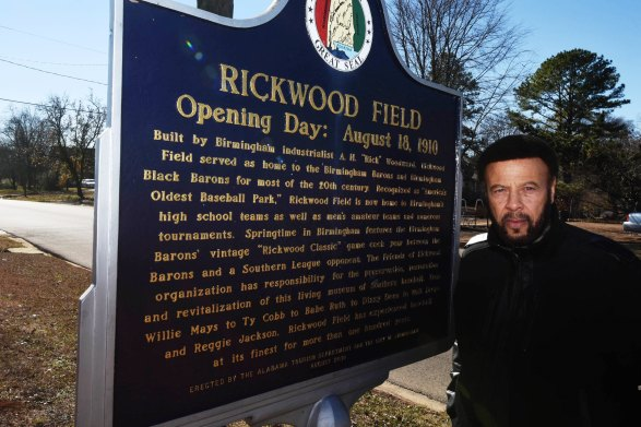Artie Wilson Jr. poses next to the Rickwood Field historical marker. (Solomon Crenshaw Jr. / Alabama NewsCenter)