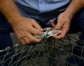 Steve Sprinkle works on a net in his Bayou La Batre shop. (Karim Shamsi-Basha/Alabama NewsCenter)