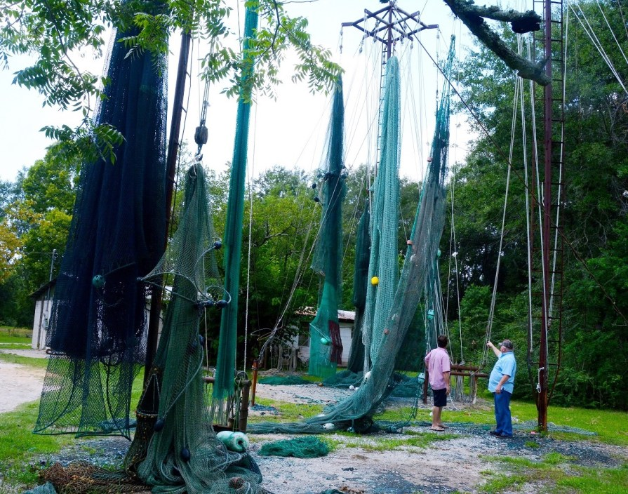 Massive shrimp nets hang outside Steve Sprinkle's net shop in Bayou La Batre. (Karim Shamsi-Basha/Alabama NewsCenter)