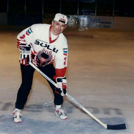 """Art Clarkson poses on the ice of the BJCC. He's dressed as though ready to play hockey, except he's wearing sneakers instead of ice skates. """"I couldn't skate,"""" he admits. (contributed)"""