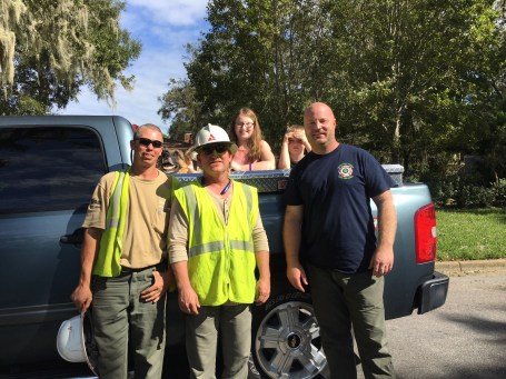 A firefighter, who had himself worked 66 hours after Hurricane Matthew hit Georgia in October, stops by to thank an Alabama Power crew for efforts to restore power in the area. (Contributed)