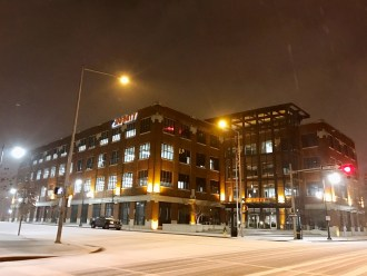 Snow covers the already quiet streets of downtown Birmingham Friday night. (Deon Gordon/Alabama NewsCenter)