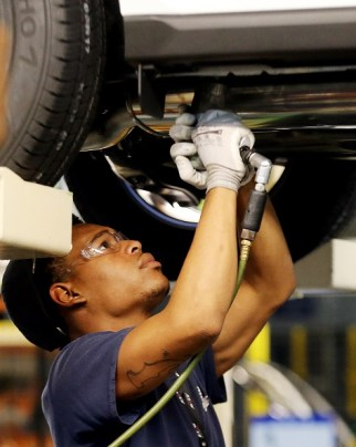 An employee in Alabama's Hyundai plant works on the Santa Fe Sport. (Jamie Martin/Governor's Office)