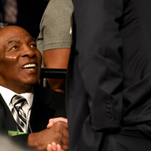 Earnie Shavers shakes hands at his seat at ringside. He is among three former champions in attendance in Legacy Arena at the Birmingham-Jefferson Convention Complex for boxing action. (Solomon Crenshaw Jr. / Alabama NewsCenter)