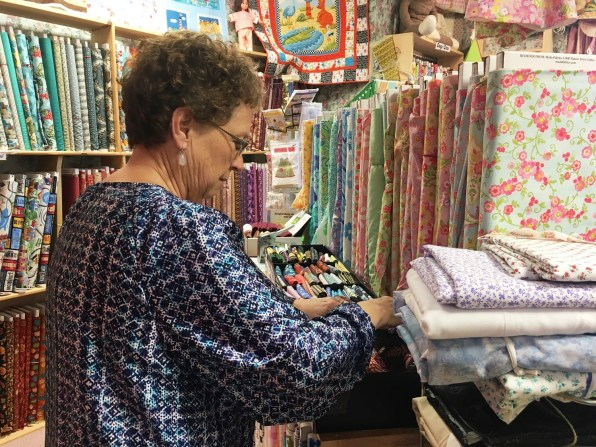A customer checks out the fabrics at Ashville House Quilt Shop. (Brittany Faush-Johnson/Alabama NewsCenter)