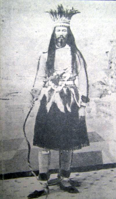 Joe Cain dressed as his Mardi Gras fictional character, Chickasaw Chief Slackabamarinico. His role as Slackabamarinico is noted on his gravestone in the Church Street Cemetery in Mobile. (Wikimedia, the University of South Alabama)