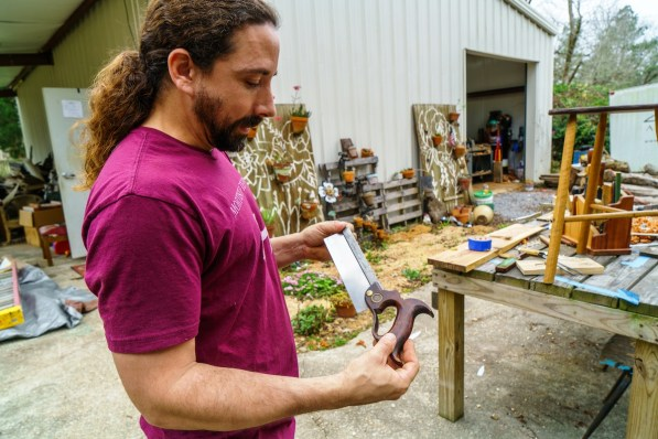 Shannon Brantley loves the history that comes with old woodworking tools. (Mark Sandlin / Alabama NewsCenter)