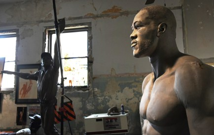 Caleb O'Connor's Deontay Wilder statue in the artist's Tuscaloosa studio, with a version of his Willie Mays statue in the background. (Solomon Crenshaw Jr./Alabama NewsCenter)