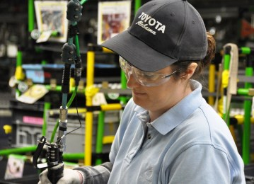An employee at Toyota Motor Manufacturing Alabama works on an engine. The plant turned out almost 700,000 engines last year. (Toyota)