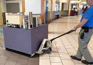 McWane employees moved the model carefully. (Wesley Higgins)