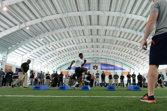Carl Lawson goes through drills during Auburn Pro Day. (Dakota Sumpter/Auburn Athletics)