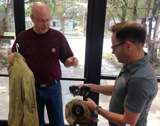 Actor Dane Peterson, right, gets a mint-condition loaner World War II flight suit to help him get into character as war hero Alvin Vogtle. (Michael Sznajderman/Alabama NewsCenter)