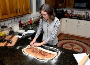 Kate Wood prepares her hazelnut cinnamon rolls. (Ted Tucker/Shorelines)