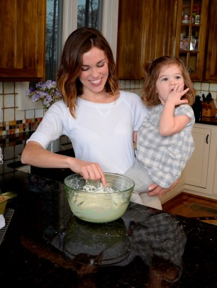 Kate Wood cooks up a batch of hazelnut cinnamon rolls with daughter Aimee. (Ted Tucker/Shorelines)