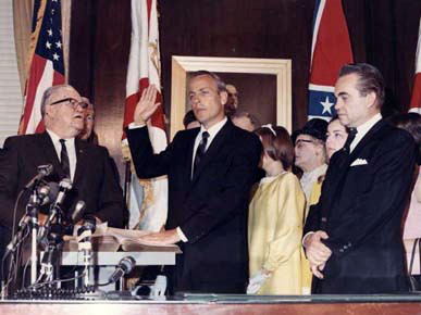 Albert Brewer was sworn in as governor of Alabama on May 7, 1968. Chief Justice J. Ed Livingston, left, administered the oath, as former Gov. George Wallace, right, observed the ceremony. (From Encyclopedia of Alabama, Courtesy of Alabama Department of Archives and History)