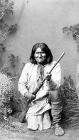 Photograph shows Geronimo, full-length portrait, facing front, posed on one knee, holding rifle, c. 1886. (Library of Congress Prints and Photographs Division)