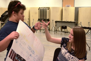 Lauren Nowak developed an instant rapport with the students in her drum circle at Homewood Middle School. (Karim Shamsi-Basha/Alabama NewsCenter)