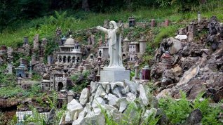 """Ave Maria Grotto, Cullman. Known as """"Jerusalem in Miniature,"""" this four-acre park (dedicated in 1934) was designed to provide a setting for 125 miniature reproductions of famous historic buildings and shrines. It is the work of Brother Joseph Zoettl, a Benedictine monk of St. Bernard Abbey. (The George F. Landegger Collection of Alabama Photographs in Carol M. Highsmith's America, Library of Congress, Prints and Photographs Division)"""