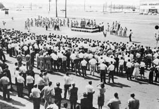 Dr. Wernher von Braun and Maj. Gen. August Schomburg officiate the official transfer of the Army Ballistic Missile Agency (ABMA) to the NASA George C. Marshall Space Flight Center (MSFC) on July 1, 1960. The Official transfer ceremony took place in the front of the ABMA-MSFC joint headquarters, building 4488, Redstone Arsenal, Alabama. (Photo credit: NASA)