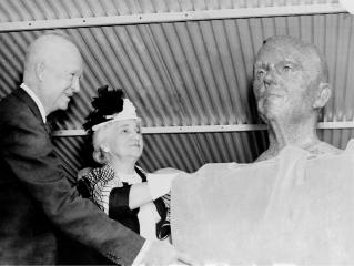 President Dwight D. Eisenhower and Mrs. George C. Marshall unveil the bronze bust of General George C. Marshall during the dedication of the Marshall Space Flight Center. Eisenhower signed an Executive Order on October 21, 1959 directing the transfer of persornel from the Redstone Arsenal's Army Ballistic Missile Agency Development Operations Division to NASA. On March 15, 1960, another Executive Order announced that the space complex formed within the boundaries of Redstone Arsenal would become the George C. Marshall Space Flight Center. The Center was activated on July 1, 1960, with dedication ceremonies taking place September 8, 1960. (Photo credit: NASA)