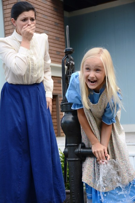 """Macy Ladner, 22, and Eleanor McCoy, 9, play the roles of Anne Sullivan and Helen Keller in the Helen Keller Festival's production of """"The Miracle Worker."""" Ladner also played the Keller role as a child. (Karim Shamsi-Basha/Alabama NewsCenter)"""