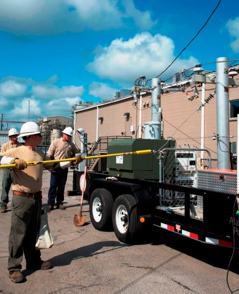 Linemen from Alabama Power's Trussville Crew Headquarters use live power equipment to show first responders what to look for and how to stay safe when working around power lines. (Brittany Faush-Johnson/Alabama NewsCenter)