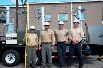 Linemen from Alabama Power's Trussville Crew Headquarters with live power equipment mounted on the Safe-T-Zone truck. (Brittany Faush-Johnson/Alabama NewsCenter)