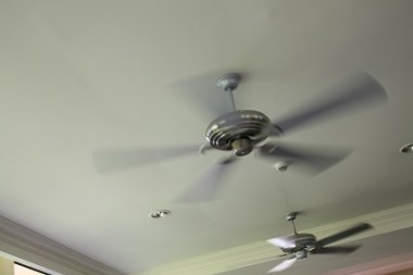 Ceiling fans are a low-cost alternative to running your air conditioner. (Getty Images)