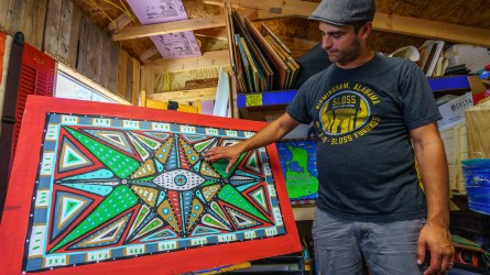 Tavis was hooked when he sold several paintings at his first art show in Tuscaloosa, and he says he has a great time making art. (Mark Sandlin/Alabama NewsCenter)