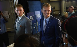 Auburn offensive lineman Braden Smith and kicker Daniel Carlson get set to walk into the Main Media Room as they began their rotations at SEC Media Days. (Solomon Crenshaw Jr. / Alabama NewsCenter)