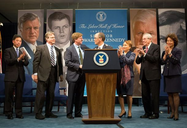 "March 12, 2015, Washington, D.C. - Secretary of Labor Thomas Perez presides over the induction ceremony of Sen. Edward ""Ted"" Kennedy into the Department of Labor Hall of Honor. On hand for the ceremony are Vicki Kennedy, Patrick Kennedy, Ted Kennedy Jr., former Department of Labor secretaries Bill Brock, Alexis Herman and Elaine Chao, and Deputy Secretary Chris Lu. (U.S. Department of Labor, Wikipedia)"
