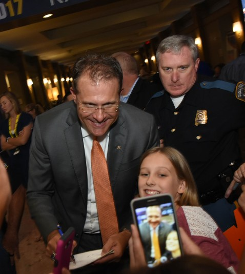 Auburn head coach Gus Malzahn poses for a selfie with a fan at SEC Media Days. (Solomon Crenshaw Jr. / Alabama NewsCenter)