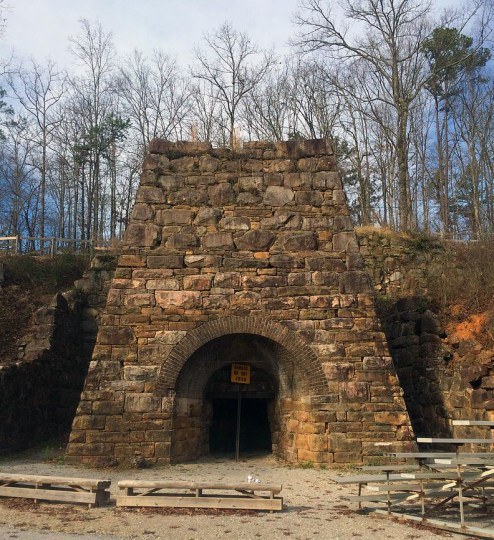The remaining stone structure of the blast furnace at Janney Furnace Park in Ohatchee, 2015. (dofftoubab, Wikipedia)