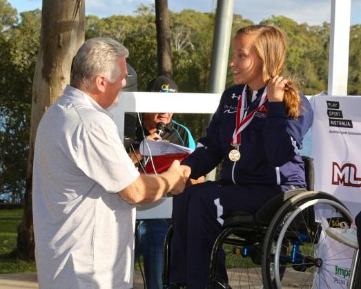 Sarah Switzer wears one of the medals she won at this year's Disabled Water Ski World Championships. (Shane Morgan)