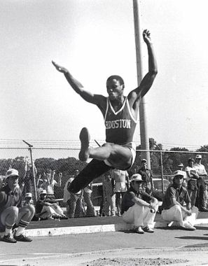 Carl Lewis in midair during a long jump for track and field as an athlete at the University of Houston. (University of Houston Libraries Special Collections, University of Houston, Wikipedia).