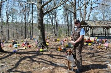 Franky Hatton with one of his dogs at the Coon Dog Cemetery. (Anne Kristoff / Alabama NewsCenter)