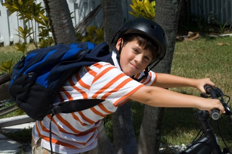 Be extra vigilant for kids on bikes in school zones and residential neighborhoods. (Getty Images)