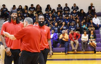 Representing the Houston Rockets at Parker High School were, from left, center Nenê, CEO Tad Brown and guard James Harden. (Michael Tomberlin / Alabama NewsCenter)