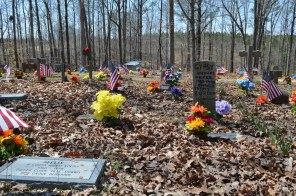 A variety of markers serve as headstones to the departed in the Coon Dog Cemetery. (Anne Kristoff / Alabama NewsCenter)