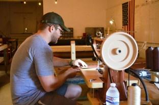 Michael Stricklin at work in his Opelika shop. (Anne Kristoff/Alabama NewsCenter)