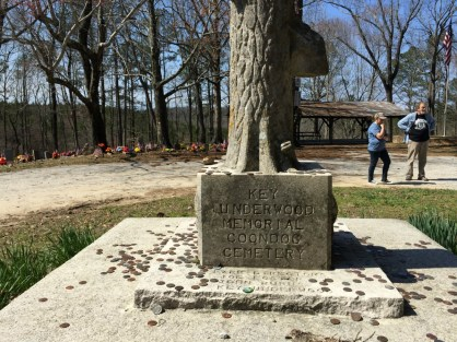 Visitors leave coins on the graves to mark that they were there. (Anne Kristoff / Alabama NewsCenter)