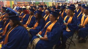 Graduates listen to program speakers before they take the stage. (Keisa Sharpe/Alabama NewsCenter)