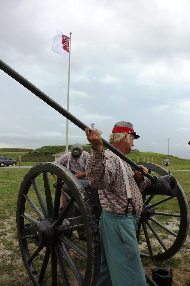 Leroy Jones of Foley swabs the barrel of the 12-pound field artillery piece during the living history event at Fort Morgan commemorating the Battle of Mobile Bay. (Robert DeWitt / Alabama NewsCenter)