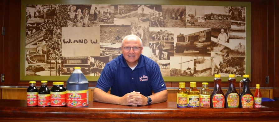 Whitfield Foods CEO Les Massey is flanked by his company's products. (Michael Tomberlin / Alabama NewsCenter)