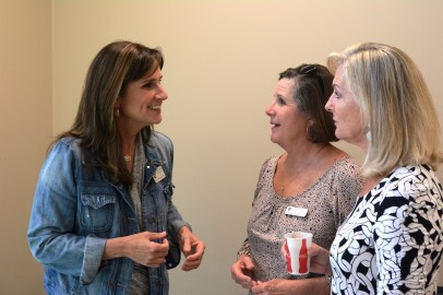 Allison Black Cornelius, left, talks with Susan Norman and Tricia Preston of the Greater Birmingham Humane Society Auxiliary. (Karim Shamsi-Basha/Alabama NewsCenter)