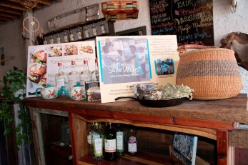 "A display promotes the film ""Little Sallie Walker."" Tips collected at Organpi Farms Farmhouse this month are going toward the project. (Brittany Faush/Alabama NewsCenter)"
