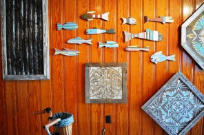 Fish, corrugated metal and hex signs are mainstays in Garland Farwell's art. (Anne Kristoff/Alabama NewsCenter)